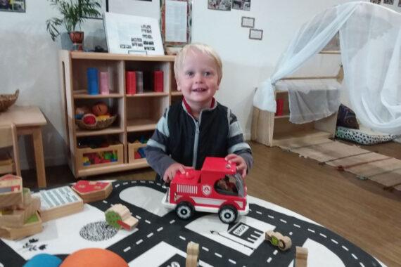 smiling toddler playing at daycare