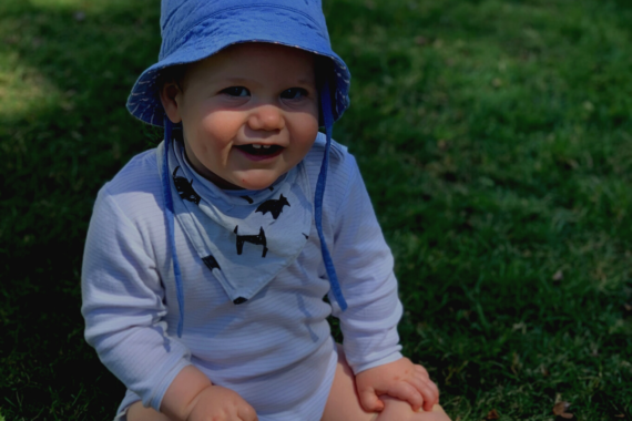 baby with hat laughing